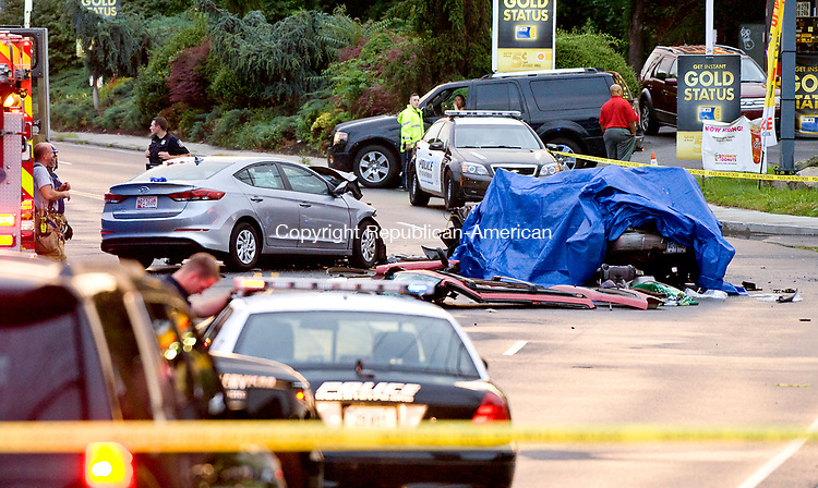 WATERBURY, CT-080217JS01-- Waterbury police and fire departments investigate a two-car collision on Homer Avenue in Waterbury on Wednesday night. Two people, one from each car, died in the accident. <br />  Jim Shannon Republican-American