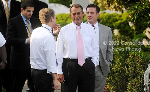 United States House Speaker John Boehner (Republican of Ohio) talks to White House spokesman Jay Carney at the Congressional Picnic on the South lawn of the White House, June 15, 2011, in Washington D.C..Credit: Olivier Douliery / Pool via CNP