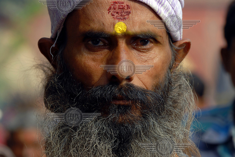 Man with beard and tika on forehead. A mass gathering takes place every year in this small Bihari village beside the Ganges River for the occasion of the Sonepur Mela, billed as the largest cattle market in the world.
