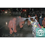 Members of the Tokyo Fire Department wearing gas masks and protective clothing are sprayed with water after exiting from Kodenmacho Subway Station in Chiyoda-ku, Tokyo on March 20th, 1995. At around 8.00am in the morning members of the Aum Shirikyo Doomsday Cult released poisonous Sarin Gas in five coordinated attacks on trains travelling through Kasumigaseki and Nagatacho stations. This resulted in the death of 13 passengers and staff and over 6,000 injuries and was Japan's deadliest act of domestic terrorism.  (Photo by Yomiuri Newspaper/AFLO)