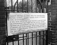 Large sign on the gates of a Roman Catholic Primary school illustrating how unwelcoming some schools were in those days.  North London.  1969.