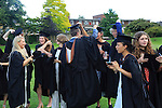 Graduates in gowns and mortarboards into the air, Goldsmiths College, University of London, England, UK