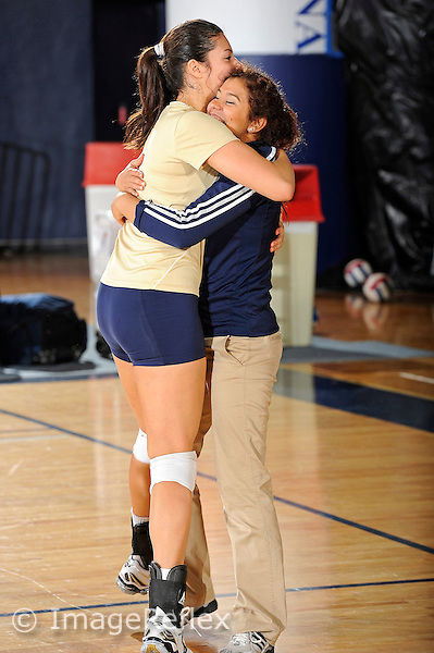 11 September 2011:  FIU Student Assistant Coach Natalia Valentin hugs Sabrina Gonzalez (12) prior to the match.  The FIU Golden Panthers defeated the Florida A&M University Rattlers, 3-0 (25-10, 25-23, 26-24), at U.S Century Bank Arena in Miami, Florida.