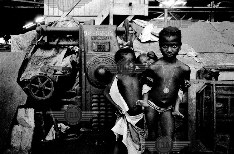Displaced children living amongst the machinery at an old factory (the National Workshop), which had become a camp for internally displaced persons (IDPs).