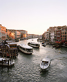 ITALY, Venice,  elevated view of people traveling in water taxi on the Grand Canal.