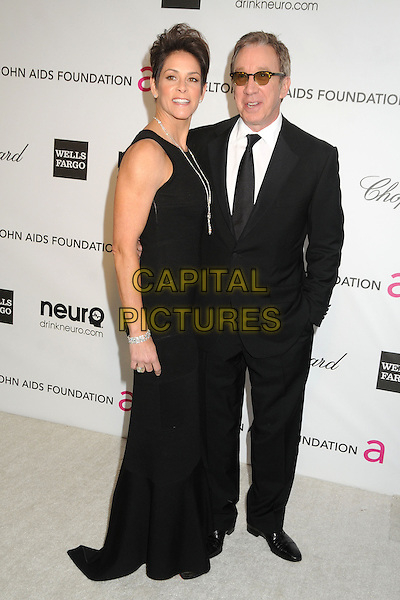 Jane Hajduk & Tim Allen.21st Annual Elton John Academy Awards Viewing Party held at West Hollywood Park, West Hollywood, California, USA..February 24th, 2013.oscars full length black dress suit sunglasses shades married husband wife .CAP/ADM/BP.©Byron Purvis/AdMedia/Capital Pictures.