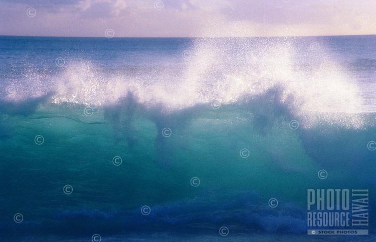 Beautiful blue wave about to break at Makaha beach, Island of Oahu