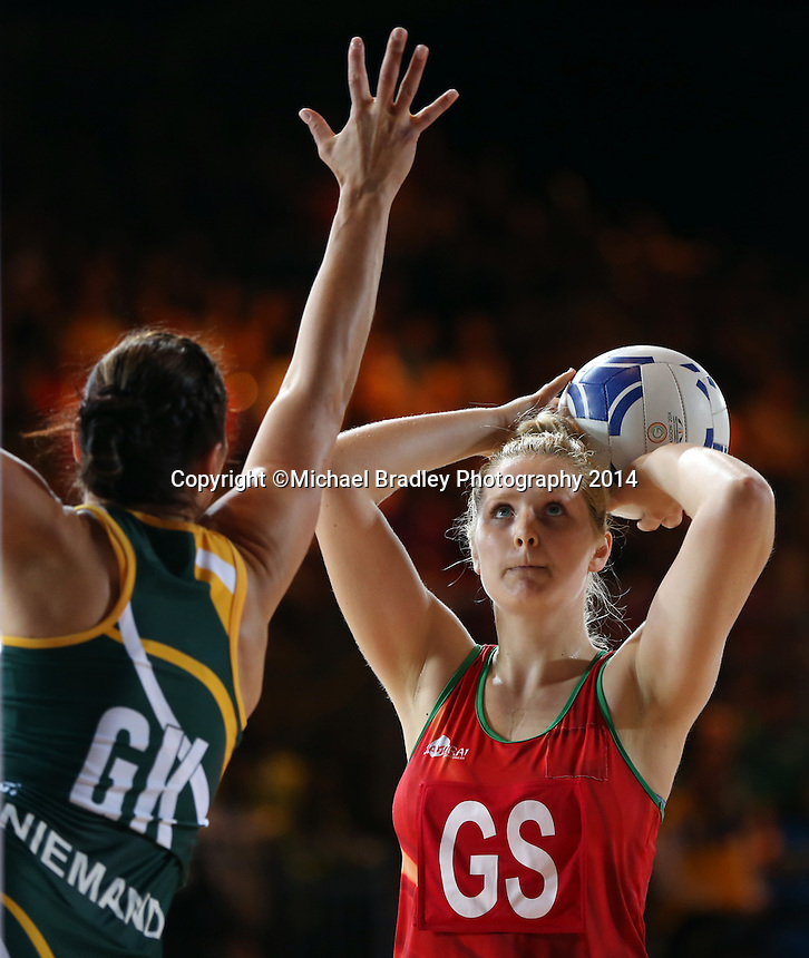 29.07.2014 Wales' Chelsea Lewis in action during the South v Wales netball match at the Commonwealth Games Glasgow Scotland on the 29th of July 2014. Mandatory Photo Credit ©Michael Bradley.