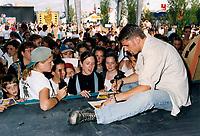 File Photo Montreal (Quebec) CANADA<br /> Marc Dupre sign autographs at a Juste Pour Rire show outside.<br /> Photo (c) P Roussel / Images Distribution