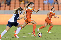 Houston, TX - Saturday July 15, 2017: Caity Heap brings the ball up the field during a regular season National Women's Soccer League (NWSL) match between the Houston Dash and the Washington Spirit at BBVA Compass Stadium.