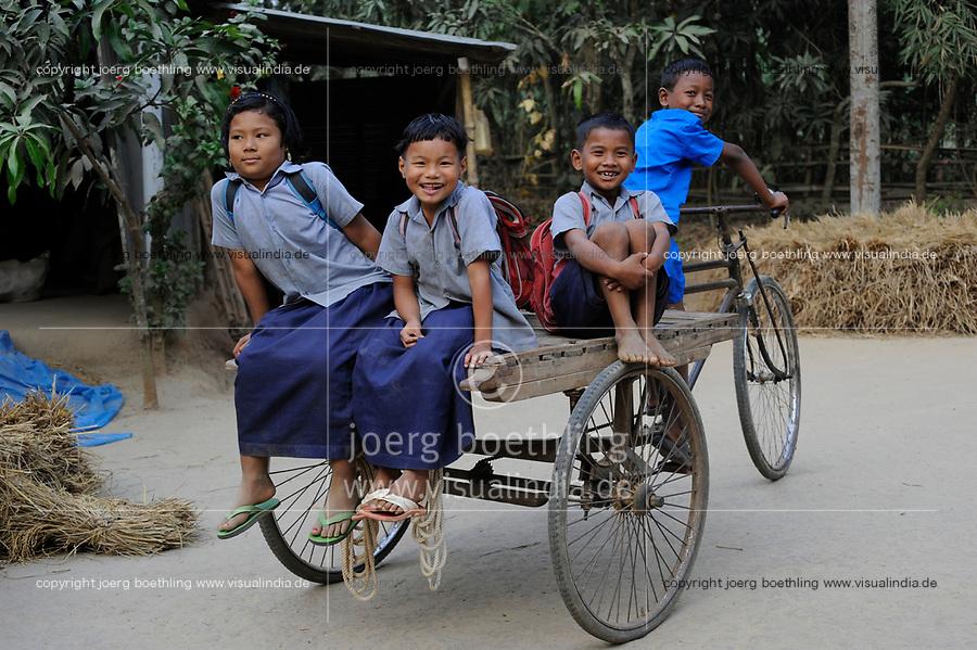 BANGLADESH Madhupur, Garo children play with bicycle rickshaw, Garos is a ethnic and christian religious minority / Bangladesch, Region Madhupur, Garo Kinder spielen mit einer Fahrrad Rikscha, Garos sind eine christliche u. ethnische Minderheit /