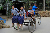 BANGLADESH Madhupur, Garo children play with bicycle rickshaw, Garos is a ethnic and christian religious minority / Bangladesch, Region Madhupur, Garo Kinder spielen mit einer Fahrrad Rikscha, Garos sind eine christliche u. ethnische Minderheit /