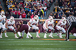 Wisconsin Badgers offensive linemen Beau Benzschawel (66), Tyler Biadasz (61), Jon Dietzen (67) and Michael Deiter (63) block during an NCAA College Big Ten Conference football game against the Minnesota Golden Gophers Saturday, November 25, 2017, in Minneapolis, Minnesota. (Photo by David Stluka)