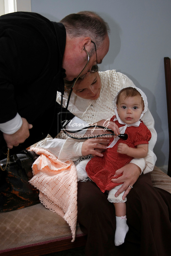 Old fashioned doctor helping a little girl listening to her heartbeat