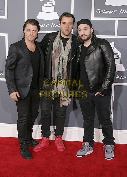 Sebastian Ingrosso, Axwell, Steve Angello of Swedish House Mafia.The 55th Annual GRAMMY Awards held at STAPLES Center, Los Angeles, California, USA..February 10th, 2013.grammys full length black leather jacket suit beige green camouflage scarf .CAP/ADM.©AdMedia/Capital Pictures.