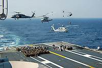 Cargo delivery photo merge aboard USS Abraham Lincoln.