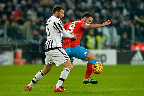 13.02.2016. Juventus Stadium, Turin, Italy. Serie A Football. Juventus versus Napoli. Andrea Barzagli is shielded by Gonzalo Higuain as he turns towards the goal