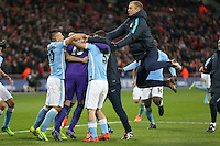 Joe Hart of Manchester City (right) joins in as Manchester City players congratulate Wilfredo Caballero of Manchester City following his saves in a penalty shoot out against Liverpool after the Capital One Cup match between Liverpool and Manchester City at Wembley Stadium, London, England on 28 February 2016. Photo by David Horn / PRiME Media Images.