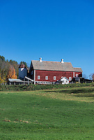 Barn and farm with snow covered field, Vermont.