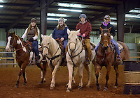 NWA Democrat-Gazette/BEN GOFF -- 02/01/15 Sophia Barnett (from left), 15, of Pea Ridge, Sidney Tisdale of Fayetteville, Cassie Barnes of Siloam Springs, and Olivia Biswell of Siloam Springs practice a 'company front' maneuver as the Rodeo of the Ozarks Rounders hold practice in Isuba Valley Horse Park near Siloam Springs on Sunday, Feb. 1, 2015.