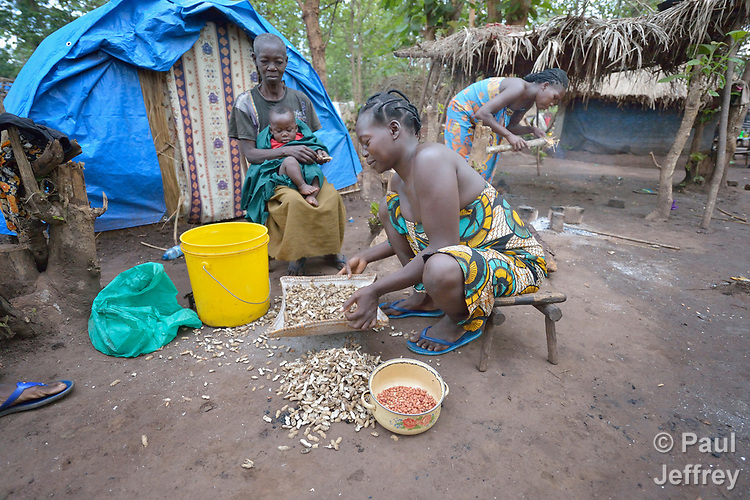 A woman shells peanuts in a camp for more than 5,000 displaced people in Riimenze, in South Sudan's Gbudwe State, what was formerly Western Equatoria. Families here were displaced at the beginning of 2017, as fighting between government soldiers and rebels escalated.<br /> <br /> Two Catholic groups, Caritas Austria and Solidarity with South Sudan, have played key roles in assuring that the displaced families here have food, shelter and water.