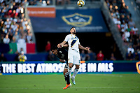 CARSON, CA - SEPTEMBER 29: Sebastian Lletget #17 of the Los Angeles Galaxy heads a ball during a game between Vancouver Whitecaps and Los Angeles Galaxy at Dignity Health Sports Park on September 29, 2019 in Carson, California.