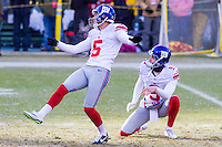 New York Giants kicker Robbie Gould (5) and punter Brad Wing (9) prior to a game against the Green Bay Packers on January 8th, 2017 at Lambeau Field in Green Bay, Wisconsin.  Green Bay defeated New York 38-13. (Brad Krause/Krause Sports Photography)