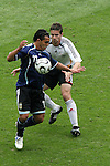 30 June 2006: Carlos Tevez (ARG) (11) positions himself between the ball and the German defender. Germany tied Argentina 1-1 at the Olympiastadion in Berlin, Germany in match 57, a Quarterfinal game in the 2006 FIFA World Cup. Germany advanced on Penalty Kicks, 4-2.