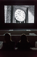 The Clock, an internationally celebrated artwork, widely regarded as a masterpiece of contemporary art, shown inside the specially designed space at Tate Modern for the first time. Christian Marclay's iconic 24-hours long video installation, is a montage of thousands of film and television images of clocks, edited together so they show the actual time, is a thrilling journey through cinematic history as well as a functioning timepiece.<br /> Christian Marclay's iconic artwork installation The Clock at Tate Modern, London, UK in 11 September 2018.<br /> CAP/JOR<br /> &copy;JOR/Capital Pictures