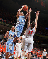 North Carolina guard Marcus Paige (5) shoots over Virginia guard Joe Harris (12) during an NCAA basketball game against Virginia Monday Jan. 20, 2014 in Charlottesville, VA. Virginia defeated North Carolina 76-61.