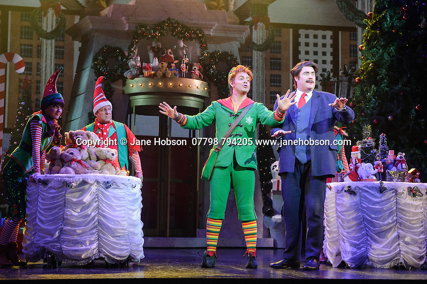 ELF THE MUSICAL opens at the Dominion Theatre, Tottenham Court Road. Picture shows: Ben Forster (Buddy),  Graham Lappin (Store Manager) and ensemble.