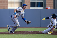 San Jose State Spartans third baseman Troy Viola (8) waits for a throw as Michigan Wolverines baserunner Jack Blomgren (2) slides into the base on March 27, 2019 in Game 1 of the NCAA baseball doubleheader at Ray Fisher Stadium in Ann Arbor, Michigan. Michigan defeated San Jose State 1-0. (Andrew Woolley/Four Seam Images)