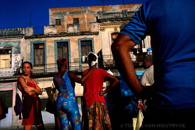 People wait for the bus in Havana, Cuba on 10 November 2002.