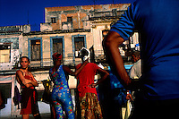 People wait for the bus in Havana, Cuba on 10 November 2002.
