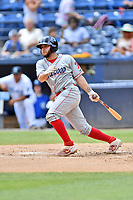 Lakewood BlueClaws Juan Aparicio (18) swings at a pitch during a game against the Asheville Tourists at McCormick Field on August 4, 2019 in Asheville, North Carolina. The Tourists defeated the BlueClaws 13-6. (Tony Farlow/Four Seam Images)
