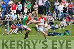 Kevin McCarthy Kilcummin turns Ger Hartnett  Mid Kerry during the SFC in Killorglin on Sunday