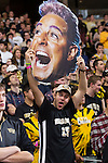 """A Wake Forest Demon Deacon fan holds up a giant head of Caesar Flickerman from """"The Hunger Games"""" prior to the men's basketball game against the North Carolina Tar Heels at the LJVM Coliseum on January 21, 2015 in Winston-Salem, North Carolina.  The Tar Heels defeated the Demon Deacons 87-71.  (Brian Westerholt/Sports On Film)"""