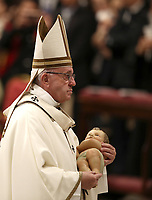 Pope Francis holds a statue of baby Jesus as he leaves at the end of the Christmas Eve Mass in St. Peter's Basilica at the Vatican, on December 24, 2018.<br /> UPDATE IMAGES PRESS/Isabella Bonotto<br /> <br /> STRICTLY ONLY FOR EDITORIAL USE