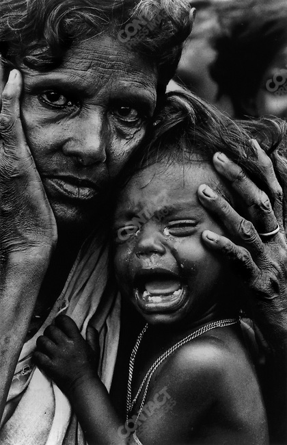 Exhausted mother and child, border of India and Bangladesh, 1971