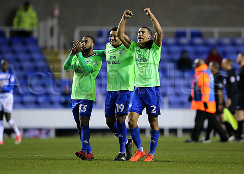 11th December 2017, Madejski Stadium, Reading, England; EFL Championship football, Reading versus Cardiff City; Cardiff's Lee Peltier, Nathaniel Mendez-Laing and Junior Hoilett celebrate with fans at full time