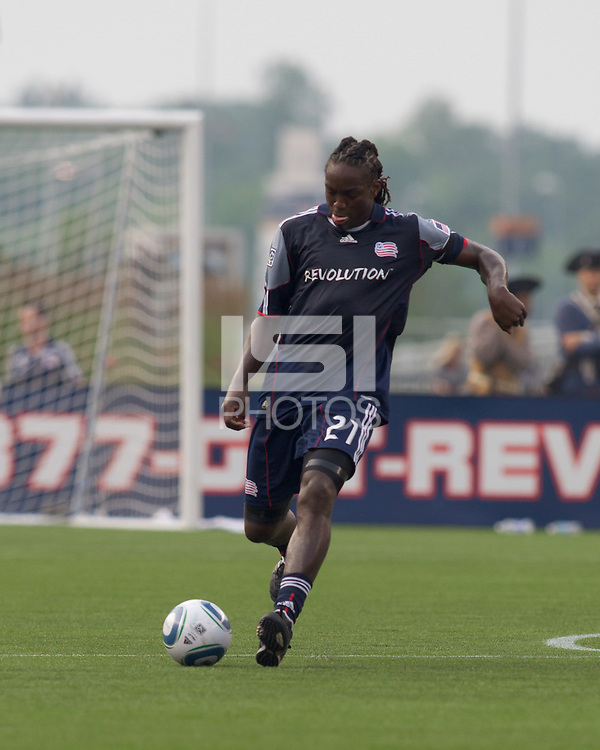 New England Revolution midfielder Shalrie Joseph (21) passes the ball. The Chicago Fire defeated the New England Revolution, 1-0, at Gillette Stadium on June 27, 2010.