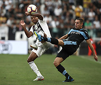 Calcio, Serie A: Juventus - Lazio, Torino, Allianz Stadium, 25 agosto, 2018.<br /> Juventus' Alex Sandro (l) in action with Lazio's Adam Marusic (r) during the Italian Serie A football match between Juventus and Lazio at Torino's Allianz stadium, August 25, 2018.<br /> UPDATE IMAGES PRESS/Isabella Bonotto