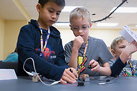 NWA Democrat-Gazette/CHARLIE KAIJO Oliver Lin, 8, (from left) and Logan Lancaster, 7, make circuits, Monday, November 25, 2019 during a two-day Mad Science camp at the Bentonville Community Center in Bentonville.<br /> <br /> Kids built circuits and learned how electricity flows in a two-day science camp led by a group of educators called Mad Science. They focused on how robots have a purpose and how they can determine that purpose. Their focus is to get kids excited about science through hands on activities. They partnered with the Bentonville Community Center to hold camps since the summer of 2018.