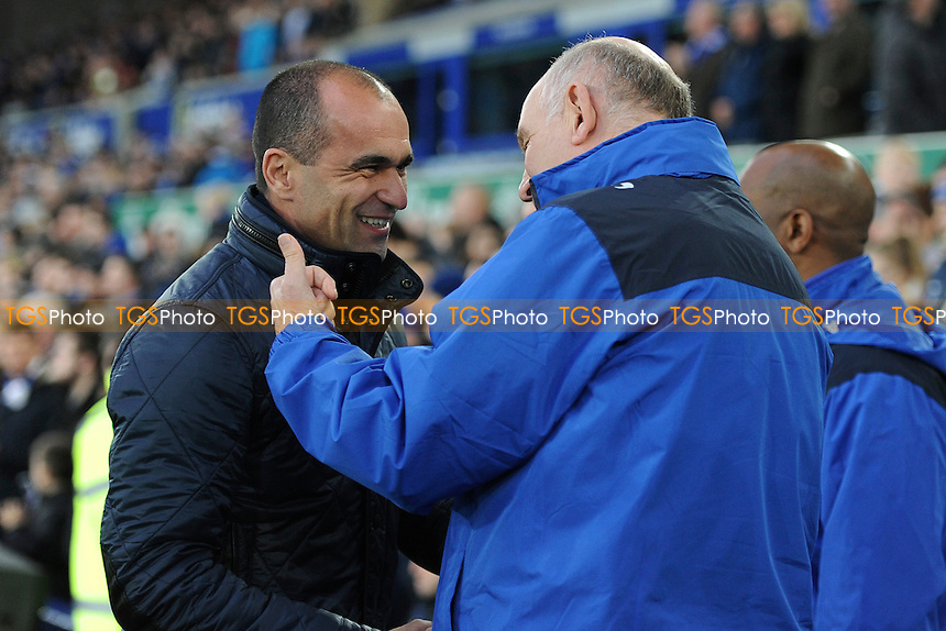 Everton manager Roberto Martínez greets Dagenham and Redbridge manager John Still during Everton vs Dagenham and Redbridge at Goodison Park