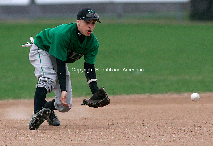 TORRINGTON, CT 4/25/07- 042507BZ11- Wilby's Jessie Thomas (4) fields the ball against Torrington Wednesday.<br /> Jamison C. Bazinet Republican-American