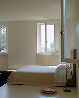 The series of windows which line the walls of the bedroom encourage the air to circulate during the hot summer months