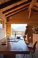 A picture window in the kitchen/dining area affords a spectacular view of the surrounding mountains