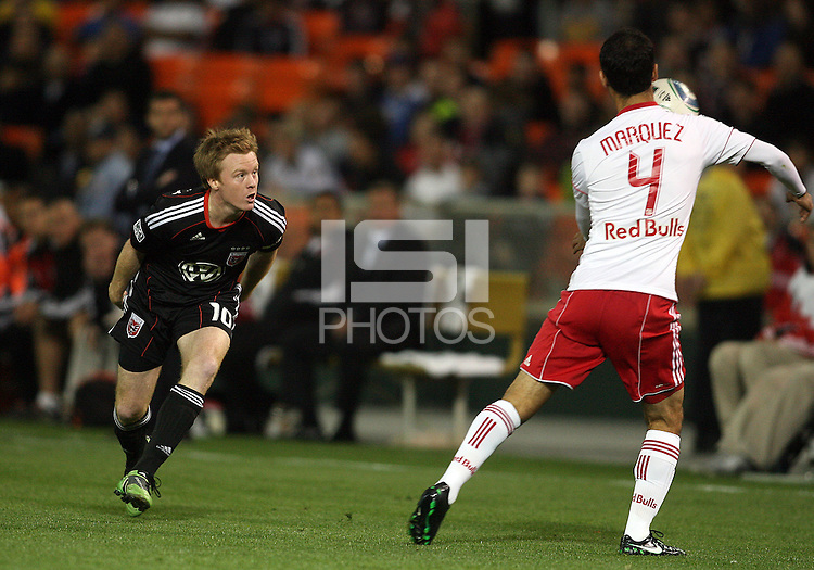 Dax McCarty (10) of D.C. United watches Rafa Marquez (4) of the New York Red Bulls bring down the ball during an MLS match at RFK Stadium, in Washington D.C. on April 21 2011. Red Bulls won 4-0.