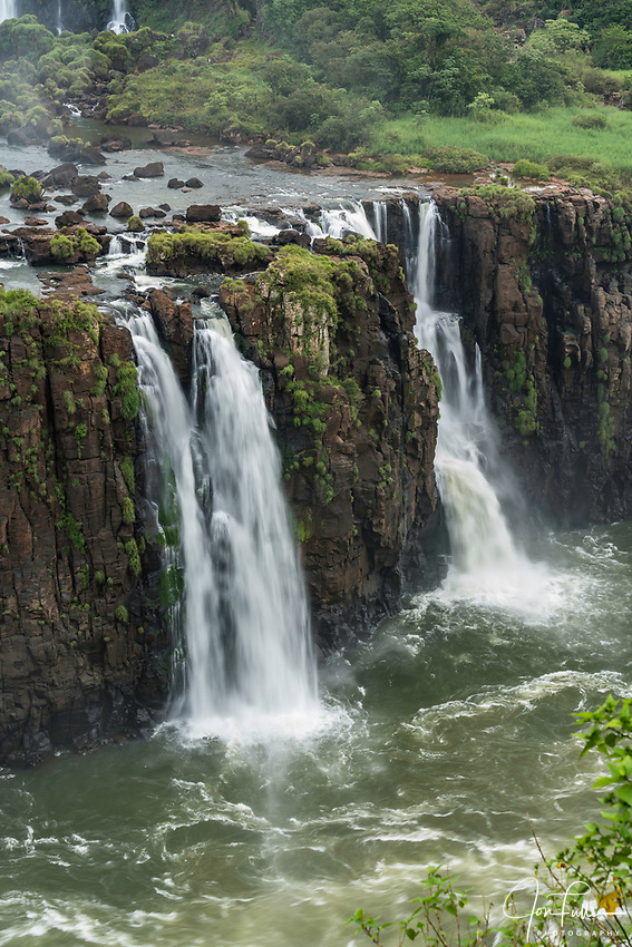 Iguazu Falls National Park in Argentina, as viewed from Brazil.  A UNESCO World Heritage Site.  Pictured are the Three Musketeers Falls or Salto Tres Mosqueteros.