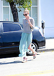 April 10th 2012 ..Kate Bosworth visits the Byron & Tracy hair salon in Beverly Hills wearing a green dress & tennis shoes sneakers with 1980s style pink purple & white Velcro laces ..AbilityFilms@yahoo.com.805-427-3519.www.AbilityFilms.com